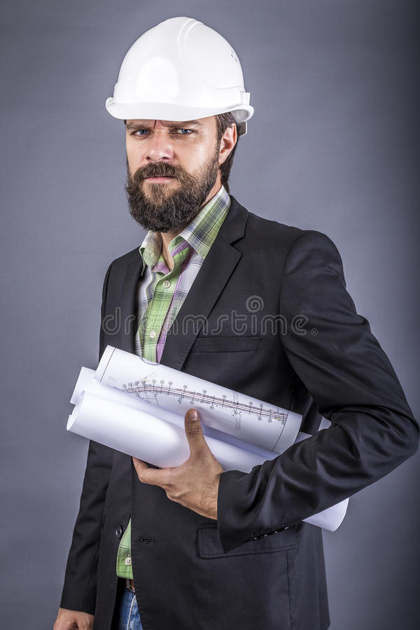 Closeup portrait of an angry engineer holding drawings stock photo