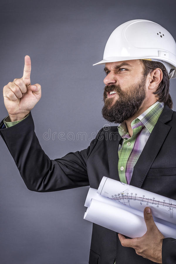 Closeup portrait of an angry engineer threatening stock photo