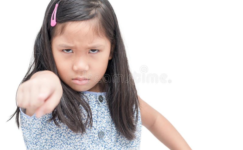 Closeup portrait angry, mad child pointing finger at someone stock photography