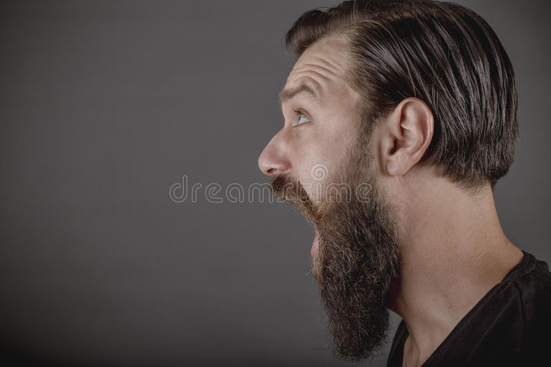 Closeup portrait of an angry young man yelling royalty free stock photos