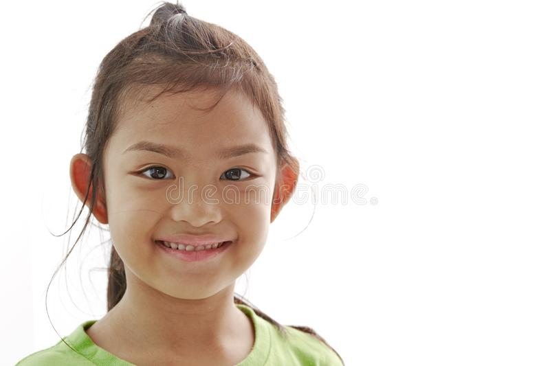 Closeup portrait of Asian little girl on white stock image