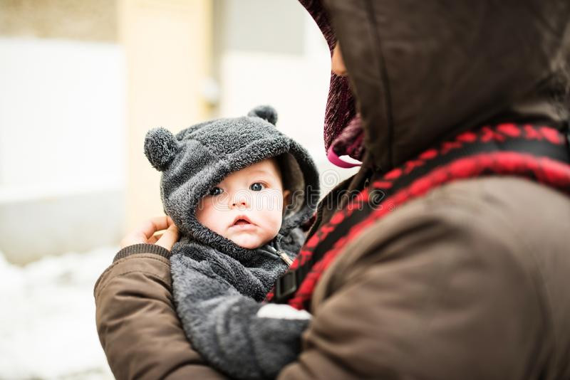 Closeup portrait of baby dressed in a bear costume royalty free stock photo
