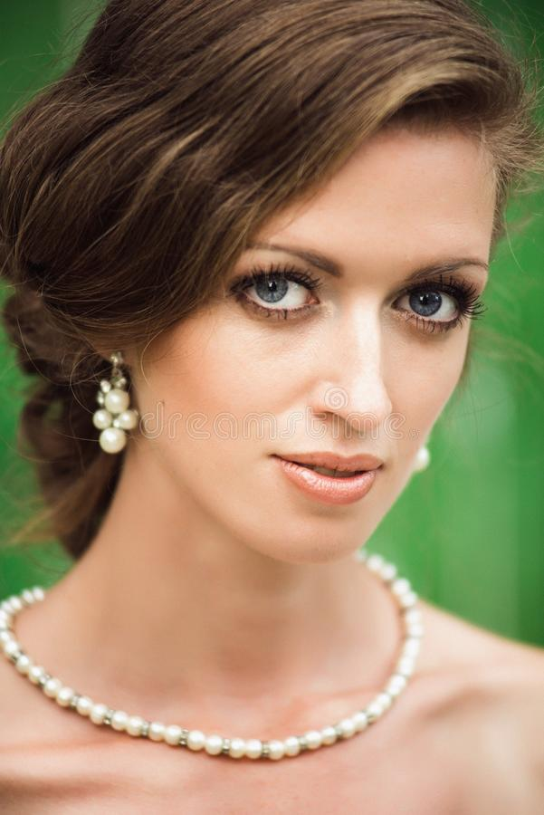 Closeup portrait of a beautiful blue eyed bride stock images