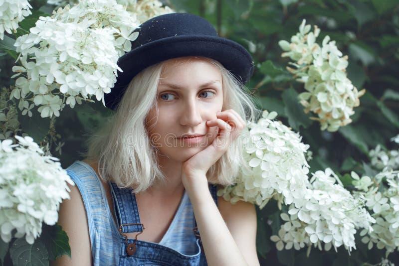 Closeup portrait of beautiful Caucasian teenage young blonde alternative model girl woman in blue tshirt royalty free stock photo