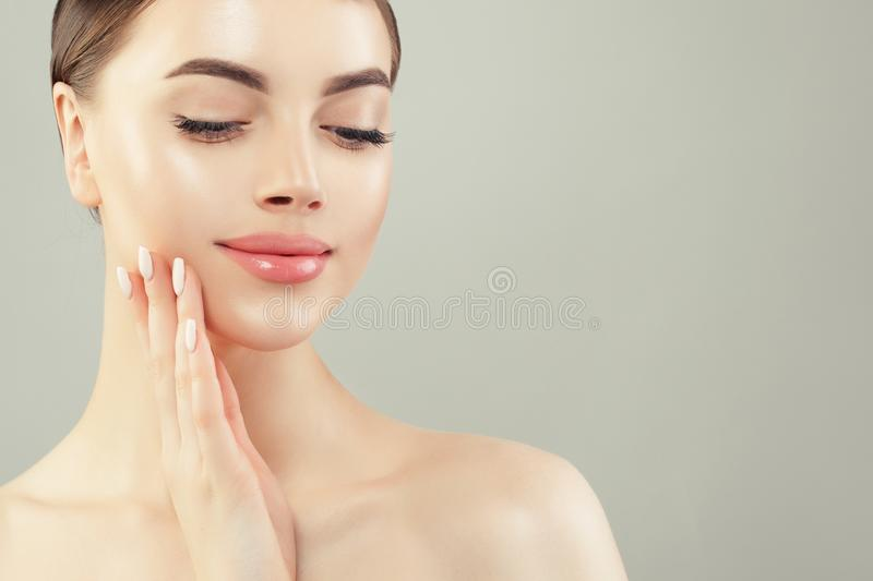 Closeup portrait of beautiful cheerful woman with clear skin stock image