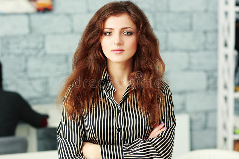 Closeup portrait of a beautiful confident businesswoman with arms folded royalty free stock image