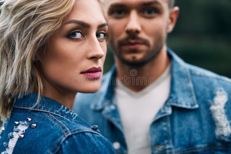Closeup portrait of beautiful couple wear denim jeans stock images