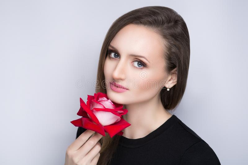 Woman with one rose stock photo