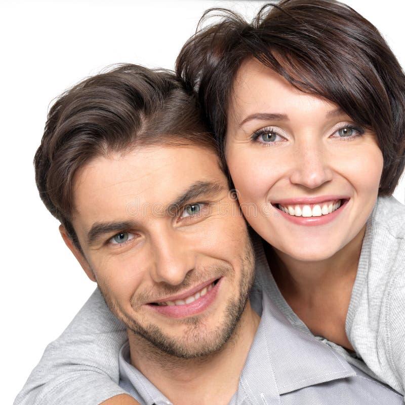 Closeup portrait of beautiful happy couple - isolated stock photo