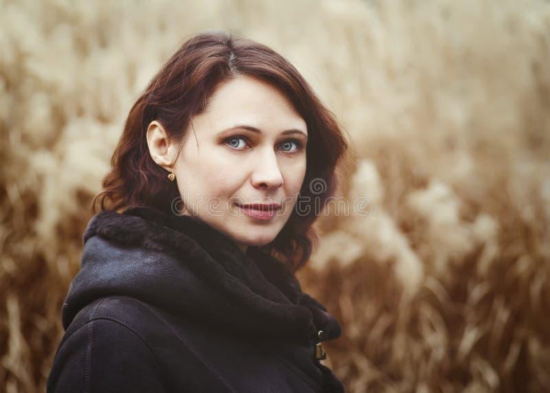 Closeup portrait of beautiful middle age white caucasian brunette woman stock images