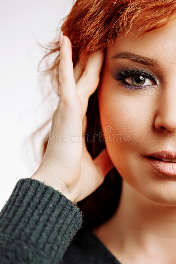A closeup portrait of a beautiful redhead woman stock images