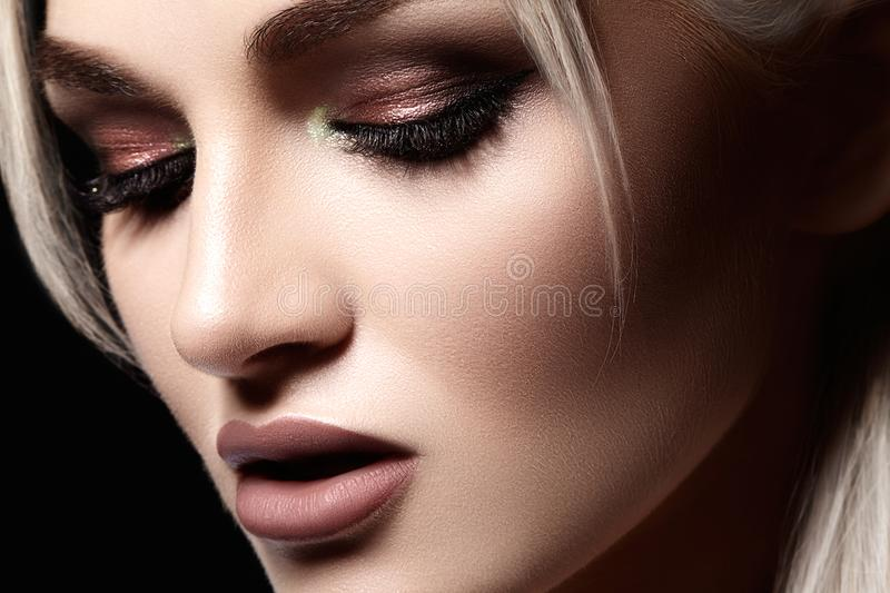 Closeup with of beautiful blond woman. Fashion makeup, clean shiny skin. Makeup and cosmetic. Beauty style on model face stock image