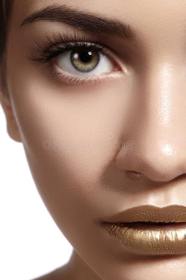 Closeup portrait with of Beautiful Woman Face. Gold fashion lip Makeup. Make-up and Cosmetic. Beauty style stock photos