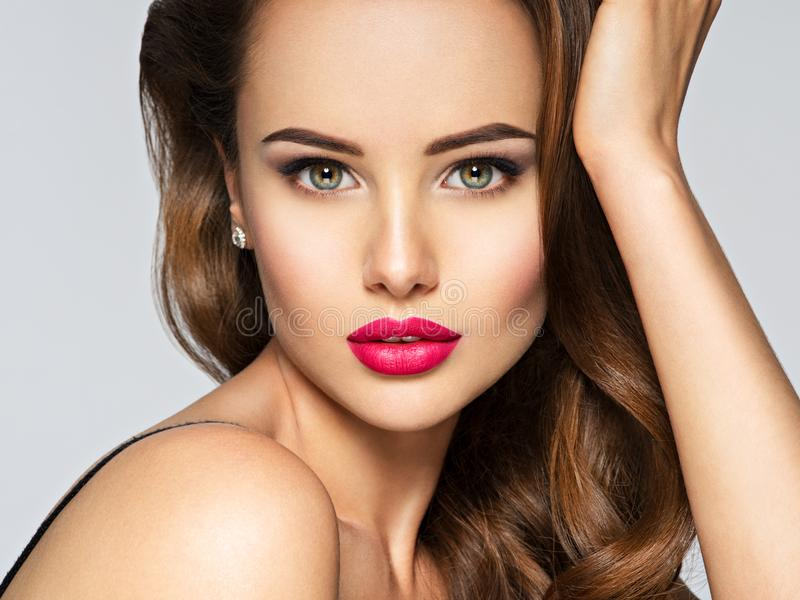 Closeup portrait of a beautiful woman with red lips. royalty free stock images
