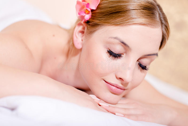 Closeup portrait beautiful young blond woman attractive girl relaxing eyes closed during spa massage treatments. Attractive girl relaxing eyes closed during spa royalty free stock image