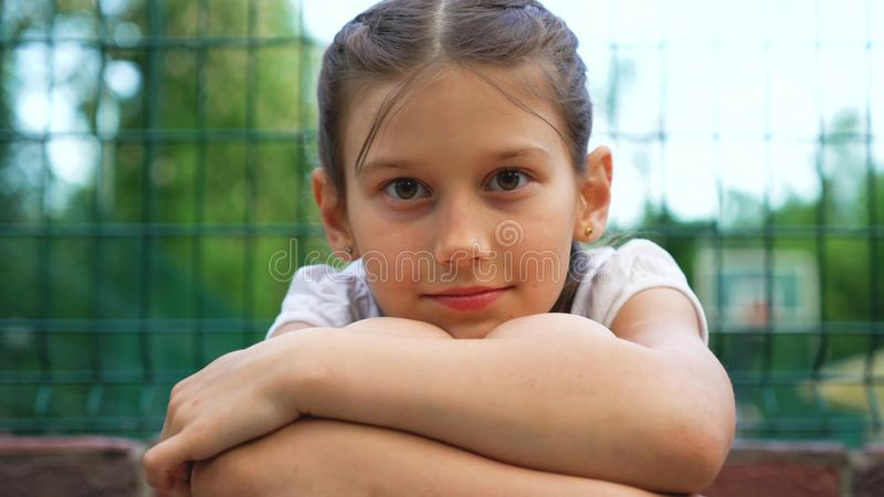 Closeup portrait of beautiful young girl with smile in park outdoor royalty free stock photos