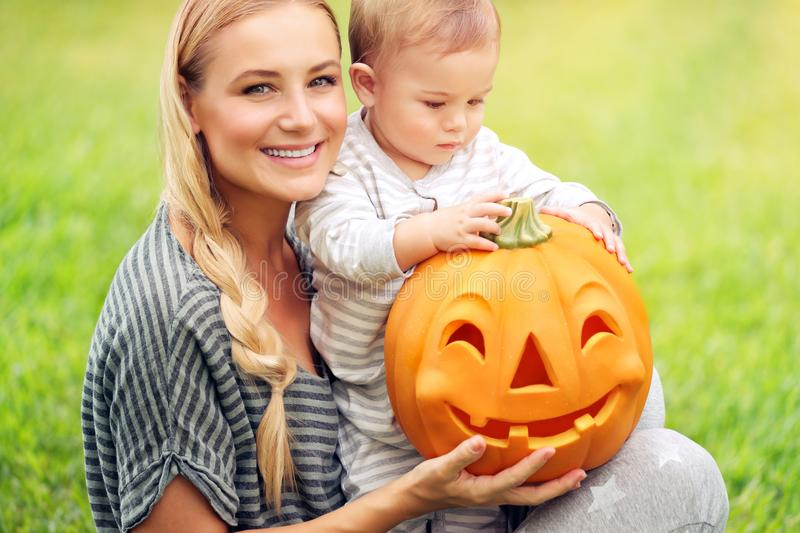 Happy family with Halloween pumpkin royalty free stock images
