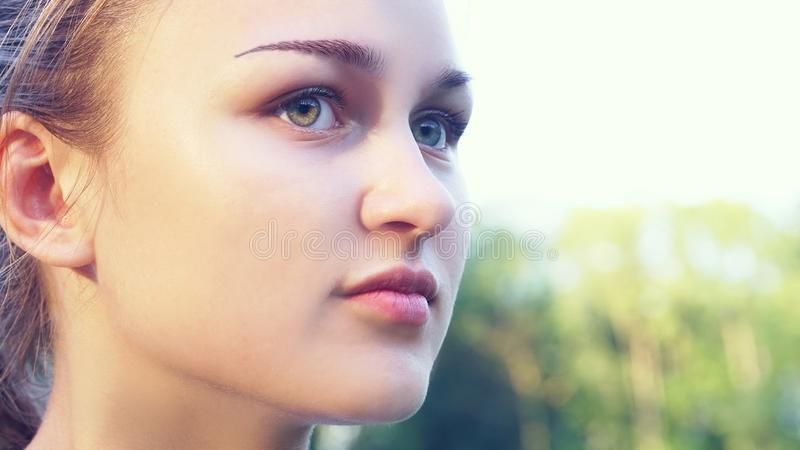 Closeup portrait of beautiful young woman with freckles. stock photos