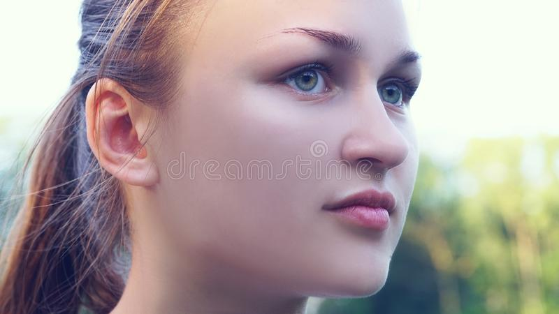 Closeup portrait of beautiful young woman with freckles. royalty free stock photography