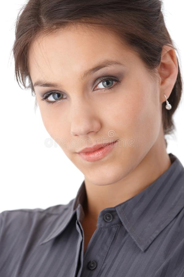 Closeup portrait of beautiful young woman smiling stock photography
