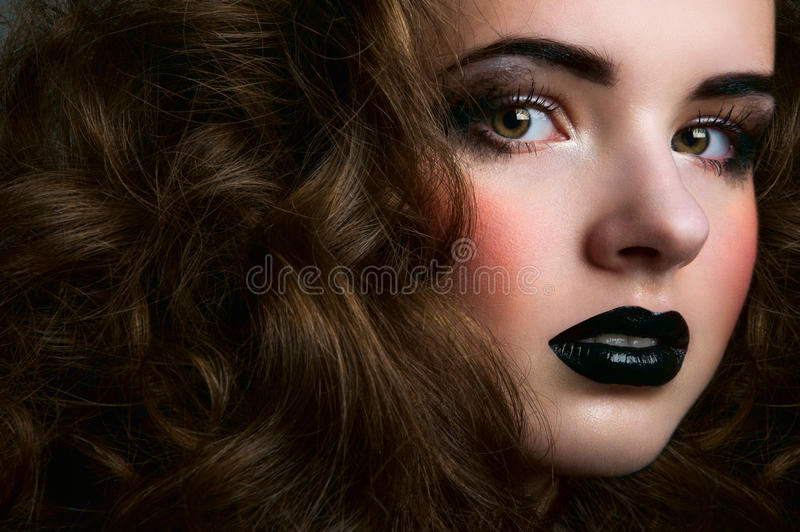 Closeup portrait of beauty female with curls stock photo