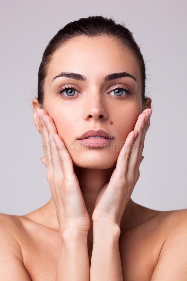 Closeup portrait of beautyful woman with clean fresh skin royalty free stock photos