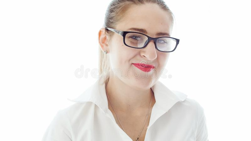 Closeup portrait of young businesswoman in eyeglasses smiling in camera royalty free stock images