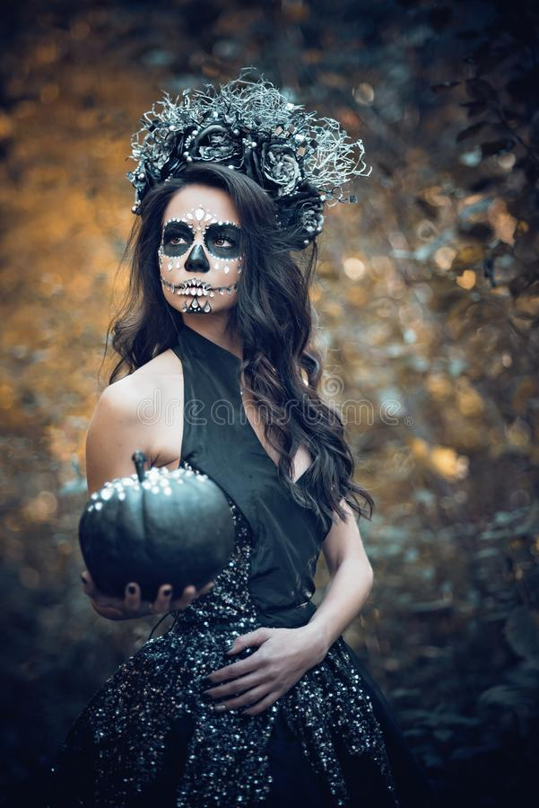 Closeup portrait of Calavera Catrina in black dress. Sugar skull makeup. Dia de los muertos. Day of The Dead. Halloween. Mexican, party, mexico, background stock photo