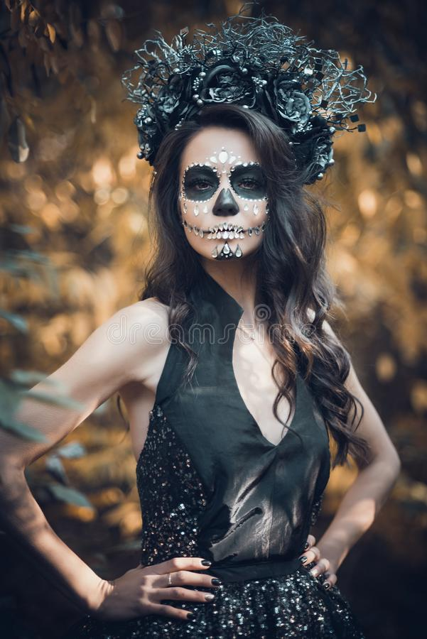 Closeup portrait of Calavera Catrina in black dress. Sugar skull makeup. Dia de los muertos. Day of The Dead. Halloween. Mexican, party, mexico, background stock photos