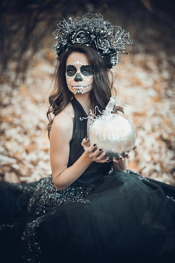 Closeup portrait of Calavera Catrina in black dress. Sugar skull makeup. Dia de los muertos. Day of The Dead. Halloween. Mexican, party, mexico, background stock images
