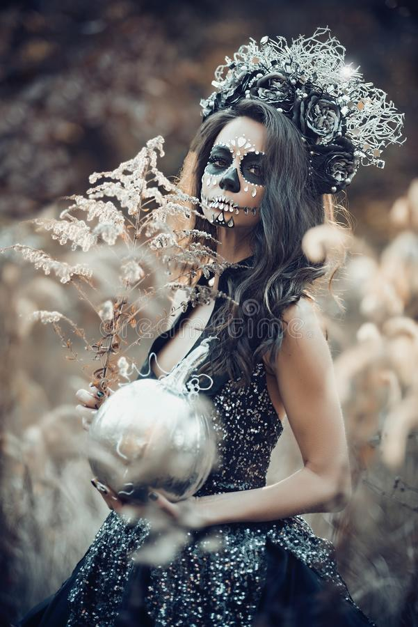 Closeup portrait of Calavera Catrina in black dress. Sugar skull makeup. Dia de los muertos. Day of The Dead. Halloween. Mexican, party, mexico, background stock image