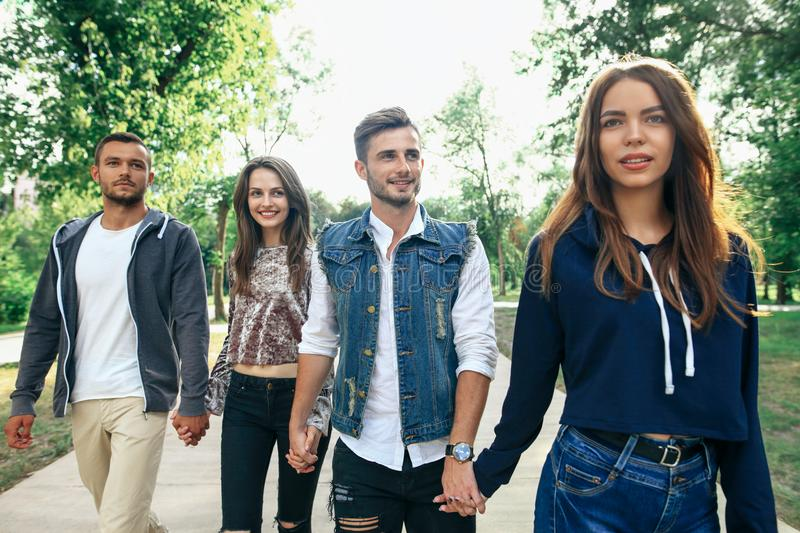 Closeup portrait of Caucasian young men and women friends outdoors royalty free stock photography