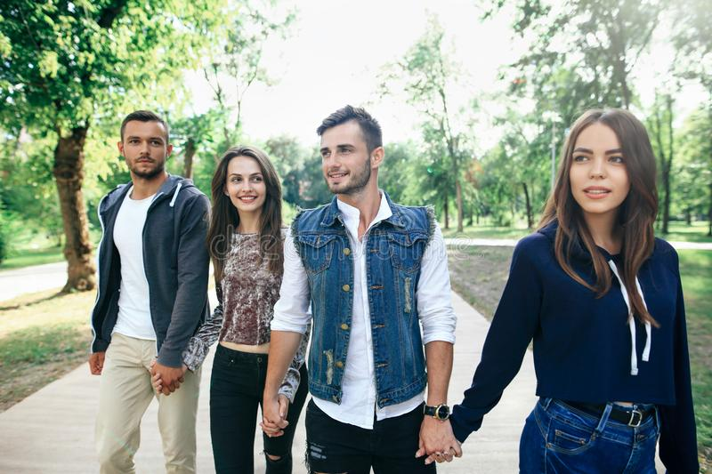 Closeup portrait of Caucasian young men and women friends outdoors royalty free stock photo