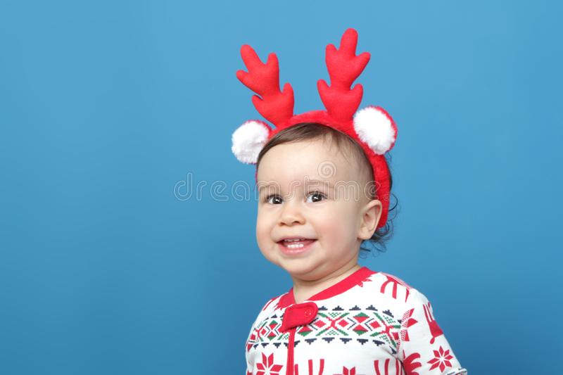 Charming little boy in Christmas pajamas royalty free stock photos