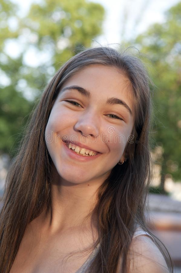 Closeup portrait of charming young female smiling royalty free stock photo