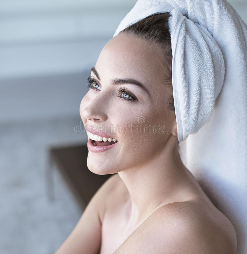 Closeup portrait of a cheerful lady in spa royalty free stock photo