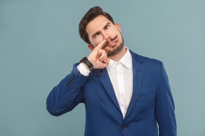 Closeup portrait of crazy man with funny face. Business people concept, richly and success. Indoor, studio shot on light blue background stock photos