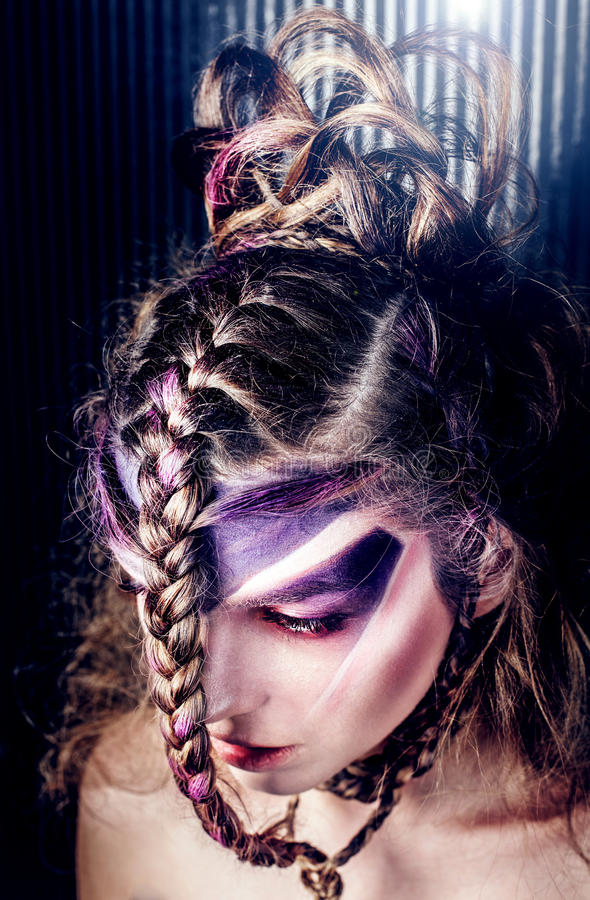 Closeup portrait of creative hairstyle. Closeup portrait of beautiful woman with creative modern hairstyle with braids and violet makeup stock images