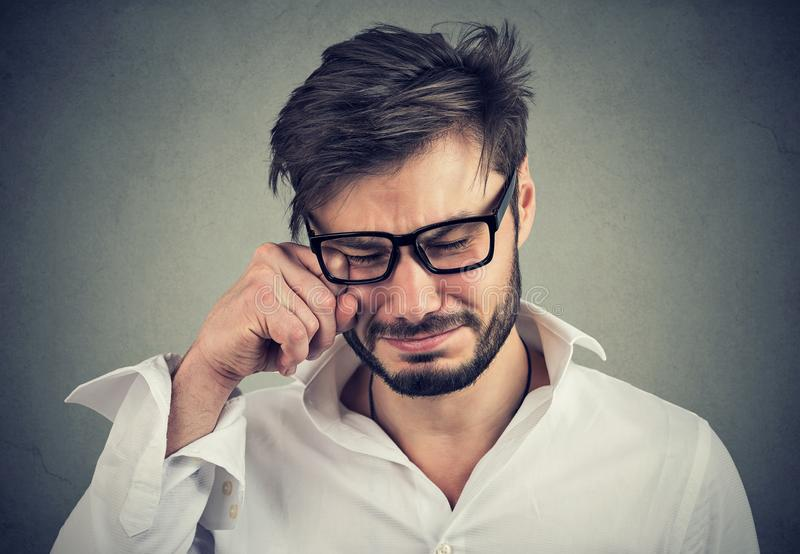 Portrait of an crying adult man in glasses royalty free stock images