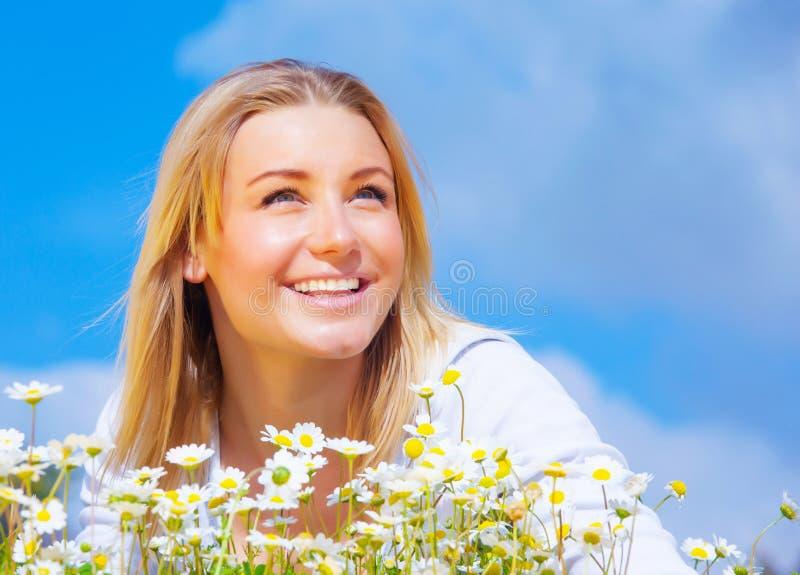 Cute female on daisy meadow royalty free stock photo