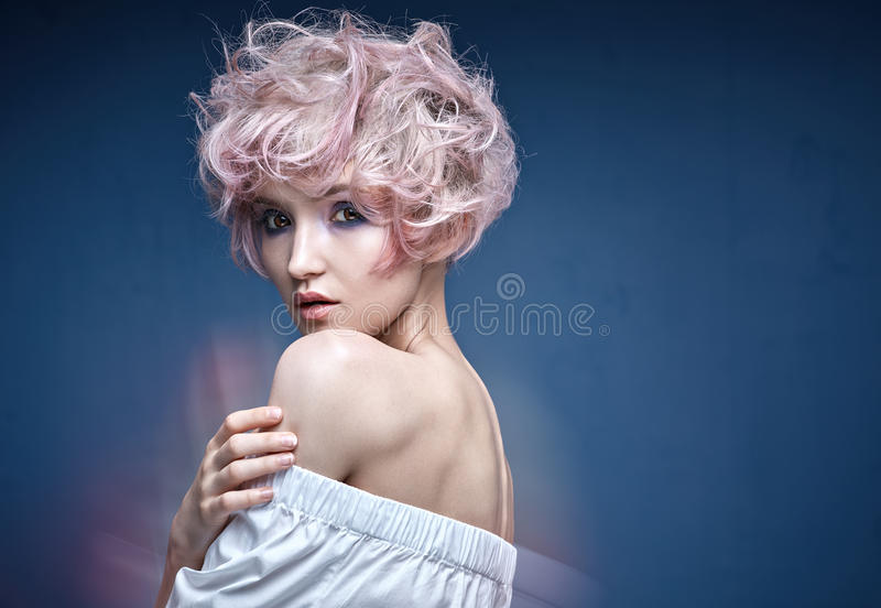 Closeup portrait of a cute girl with a pink hairstyle royalty free stock photo