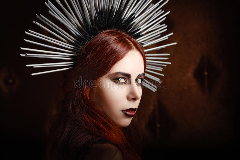 Closeup portrait of cute gothic girl wearing spiked headgear royalty free stock images