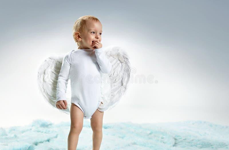 Closeup portrait of a cute little angel - boy royalty free stock photos
