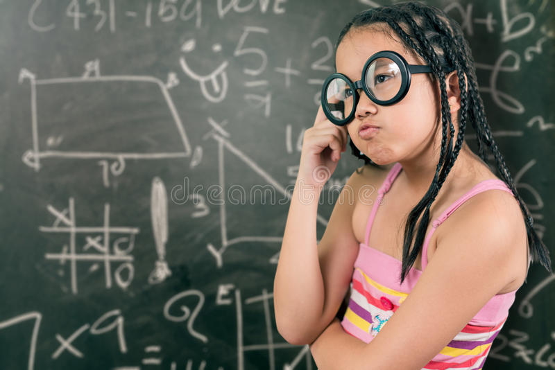 Closeup portrait of Cute little girl thinking stock images