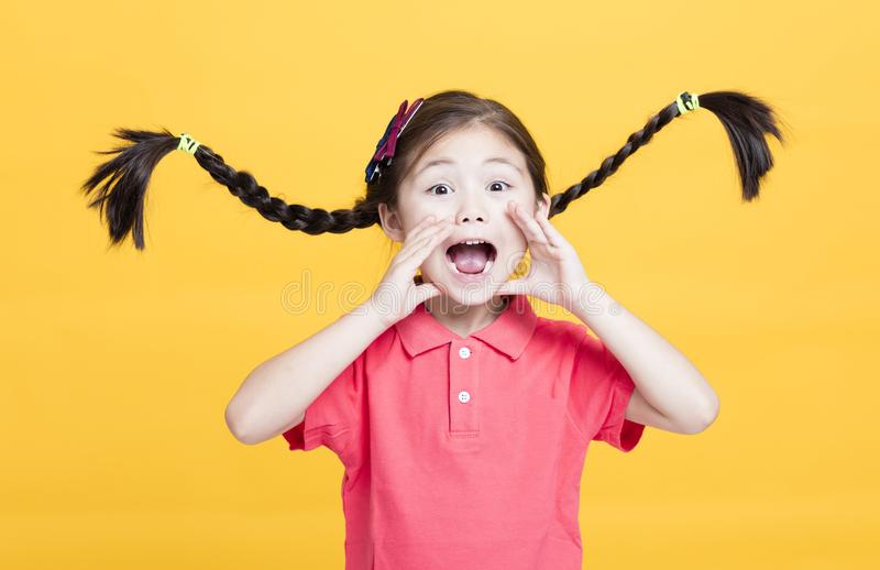 Portrait of cute little girl yelling royalty free stock photo