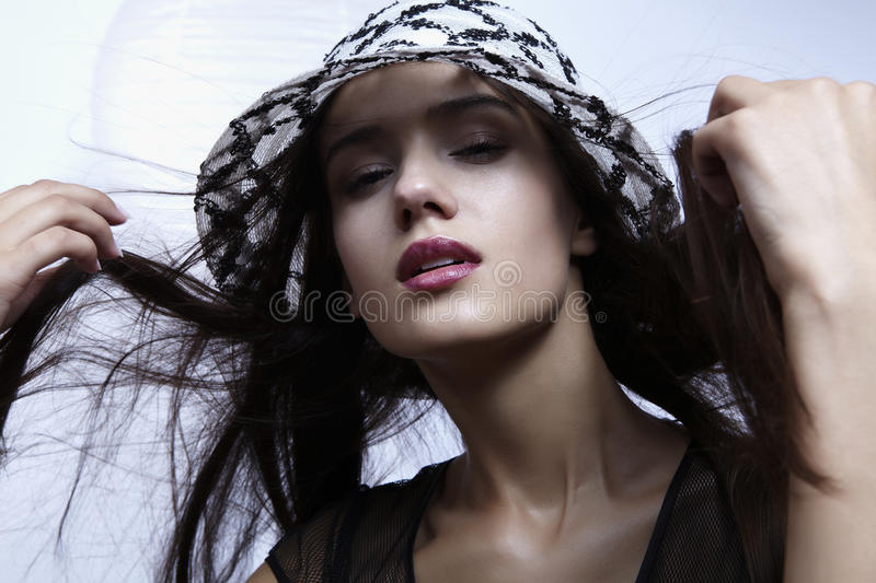 Closeup portrait of a cute young woman. Wearing a straw hat stock photography
