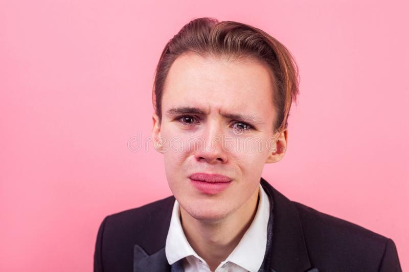 Closeup portrait of desperate man in suit crying and looking at camera with grimace of pain , insulted, deeply offended, resentful royalty free stock photos