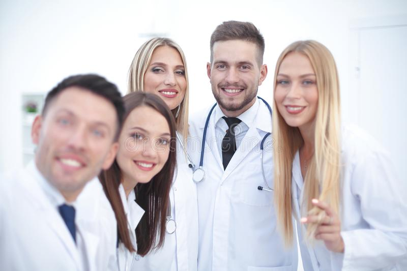 Closeup.Portrait of a doctor and medical team. On white background stock photos