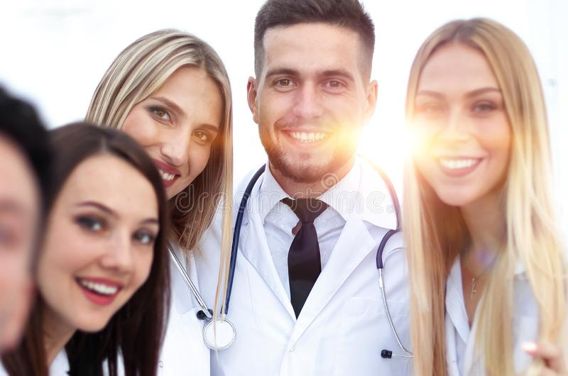 Closeup.Portrait of a doctor and medical team. On white background stock images
