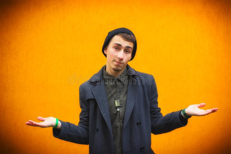 Closeup portrait of dumb, clueless young man, student, worker arms out asking what`s the problem royalty free stock photo